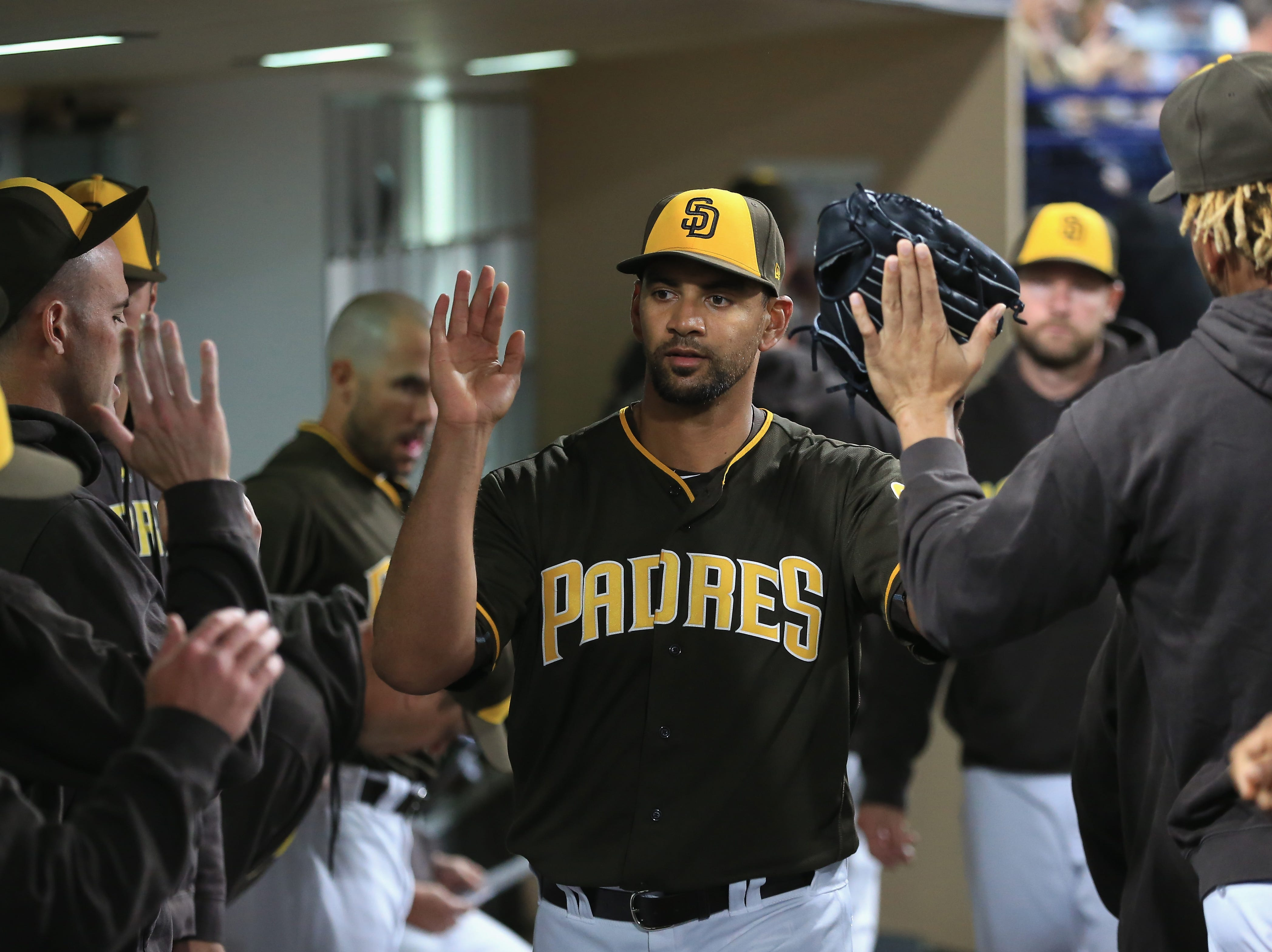 Tyson Ross of the San Diego Padres is congratulated in the dugout after being taken out of the game during the seventh inning of a game against the San Francisco Giants on April 13, 2018 in San Diego, California.