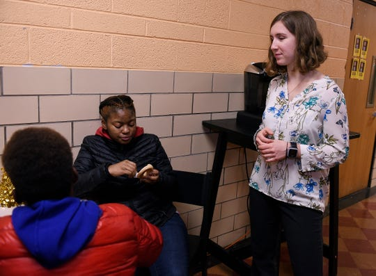 Katie Little, 24, a volunteer worker with the Christ The King Service Corps, is seen talking to l-r, Allen Smith, 14, of Detroit and Lillie Reynolds-Smith, 16, of Detroit at the St. Suzanne Cody Rouge Community Resource Center, where she works as an assistant manager. Christ the King is one of the groups receiving the first grants offered by the Catholic Foundation of Michigan, which launched last year.
