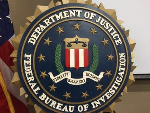 An FBI agent alleges in a court filing that a Redford women tried to hire a hit man to kill her significant other to collect on his life insurance policy.