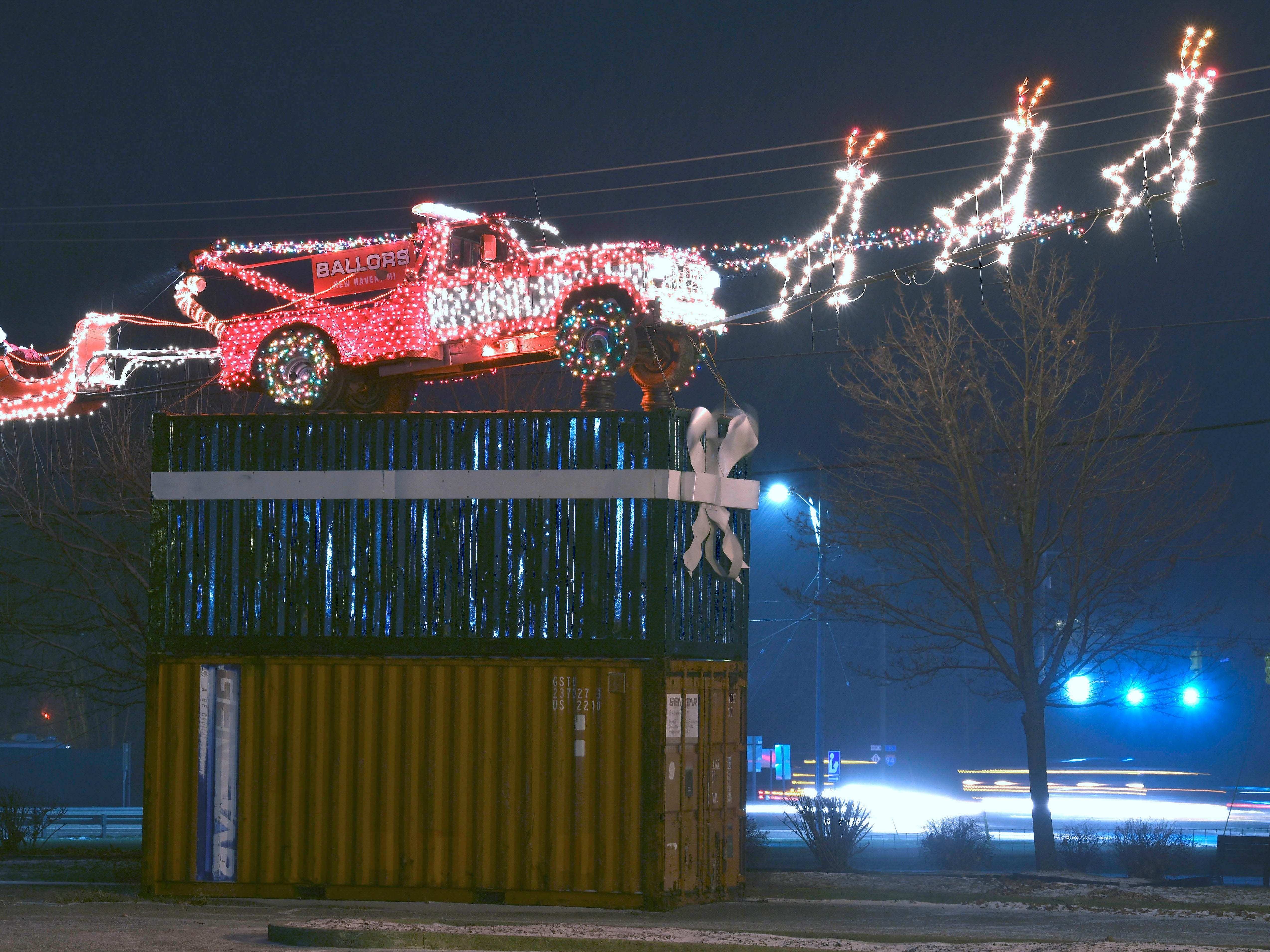 This late 1970s tow truck, with attached reindeer and Santa sitting in his sleigh, is decorated with Christmas lights 25 feet above the ground, sitting on two shipping containers at Joe Ballor Towing Inc. in New Haven, for at least the 10th year this holiday season. According to third generation owner Joel Ballor, the family decided to display the Christmas decoration out of respect for his grandparents, Joe and Elizabeth Ballor, who founded the company in 1939 across the street.