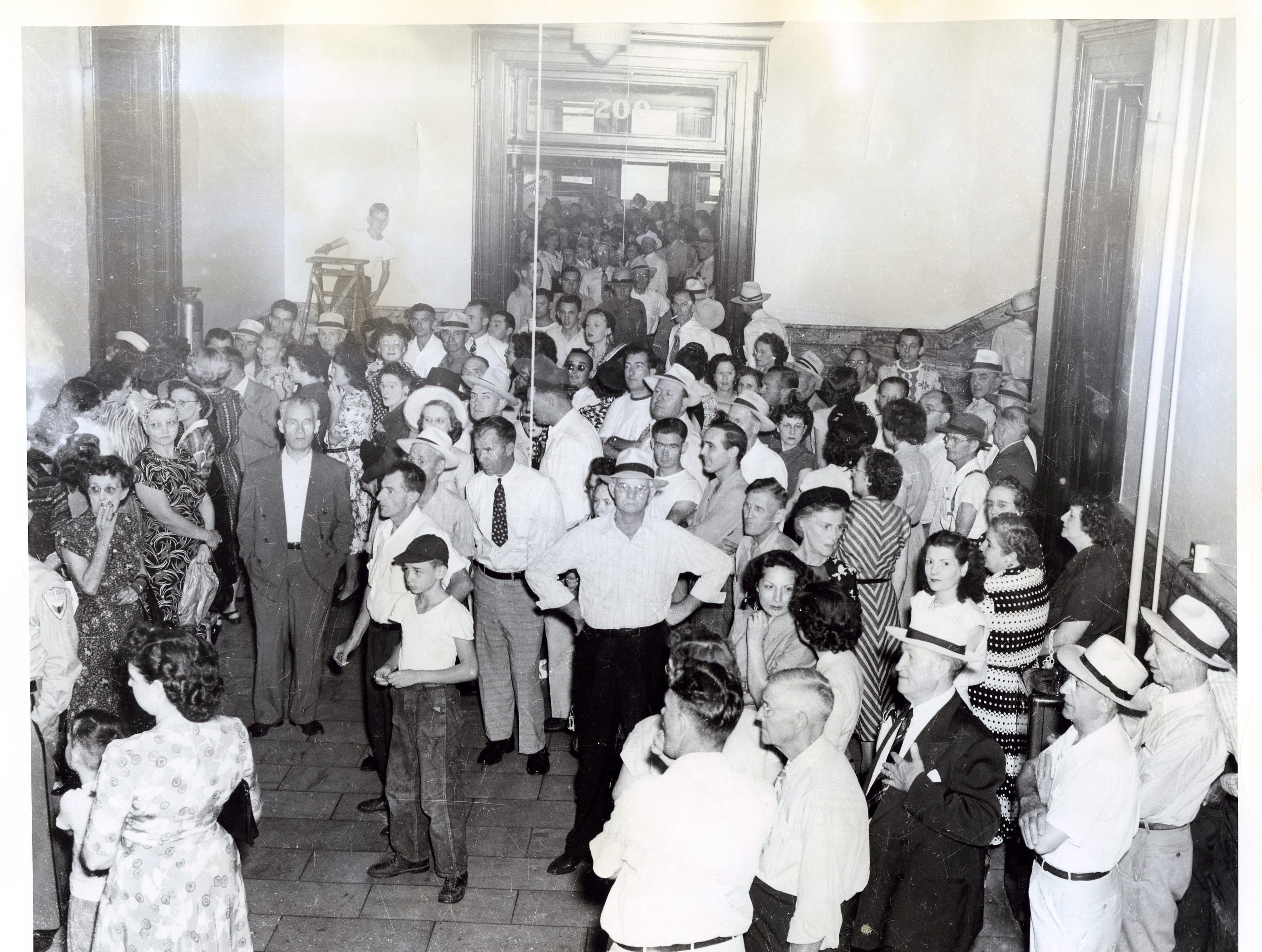 Outside the Circuit Court room of the Vanderburgh County court house, overflow crowds jammed the corridors Monday, August 29, 1950.