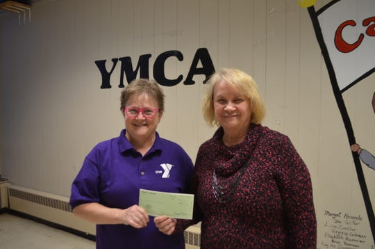 Ruth Keck, left, and Denise Reiter of the Sandusky County YMCA received a $2,500 check from the Gannett Foundation to be used for scholarships for needy local citizens who cannot afford YMCA membership.