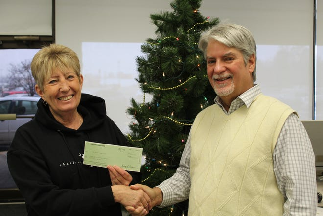 Editor David Yonke presents a check to Dianne Rozak of the Catawba Island Historical Society for $2,000 from the Gannett Foundation.