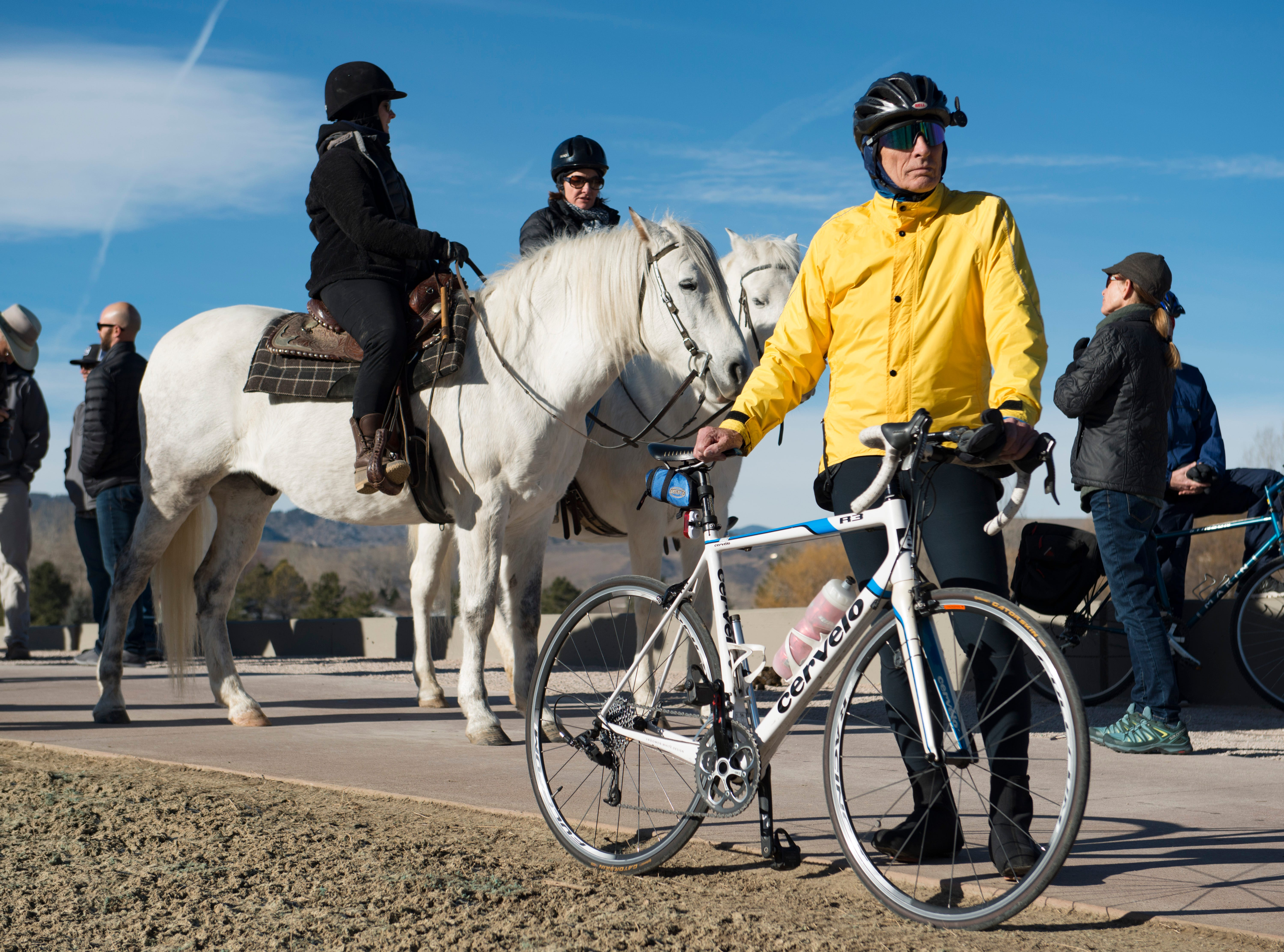 Rudy Zitty stands with his bike as he attends a ribbon-cutting for the new 70-foot-long Fossil Creek Trail pedestrian tunnel in south Fort Collins on Monday, December 10, 2018. The new 1.7 mile section of trail runs under the BNSF railway to connect College Avenue and Shields Street.