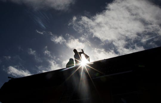 Roofers work on one of the buildings at the Jones Walker apartments in Fort Myers on Monday 12/10/2018. HUD inspectors are making final inspections in the coming days on major renovations that the complex needs. Some residents are satisfied with the renovations, others say more are needed.
