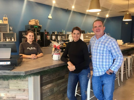 Husband and wife Chris and Lisa Wilson own Chocolattes in south Fort Myers. Maureen McLaughlin, back, is the shop's manager.