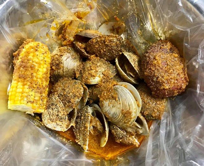 Clams shaken with garlic and seasonings from King Crab Cajun Seafood in Lehigh.
