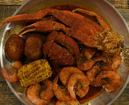J&C Crab in Fort Myers offers crab legs, shrimp and more boiled and then shaken with seasonings.