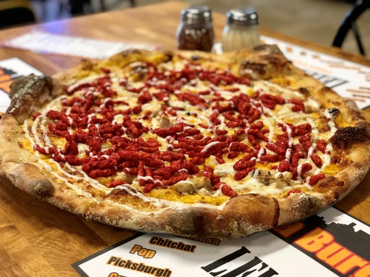The Chicken Volcano Pizza from Lelulo's Pizzeria in Cape Coral features Cheez Whiz, grilled chicken, Flamin' Hot Cheetos and ranch dressing on Lelulo's house-made, hand-stretched crust.