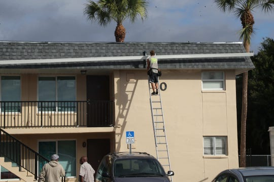 Workers feverishly finish renovations at Jones Walker apartment complex in Fort Myers in 2018. The complex has been plagued moldy walls, leaky pipes and disrepair from previous tenants. HUD is expected to perform inspections in the coming days of the newly renovated complex.