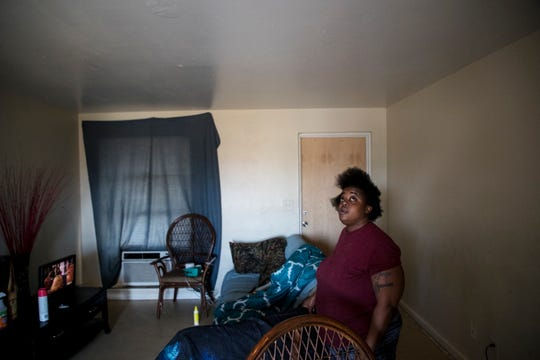 Jones Walker resident Margaret Mason stands inside her living quarters on Monday 12/10/2018. She has a new door and hurricane-impact windows but says her apartment is in need of major renovations.