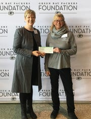 Miller Art Museum Executive Director Elizabeth Meissner-Gigstead and Community Mural Project Committee Member Mary Cram received a $3,125 grant for their project from the Green Bay Packers Foundation on Dec. 5.