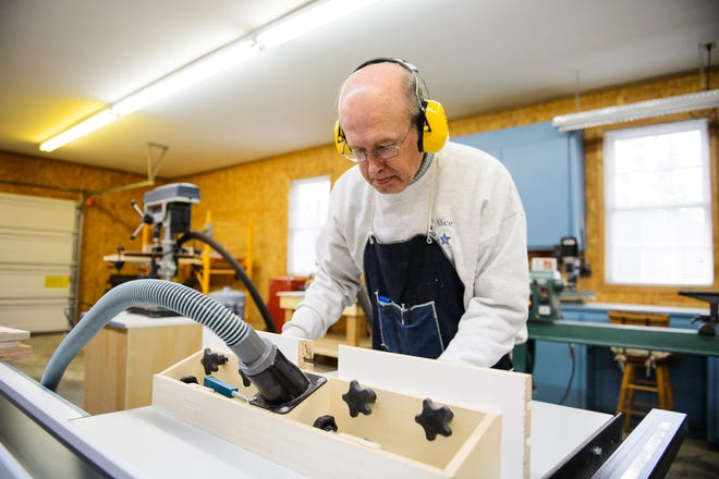 Former Sen. Larry Martin bevels a piece of wood in his workshop on Thursday, Nov. 29, 2018.