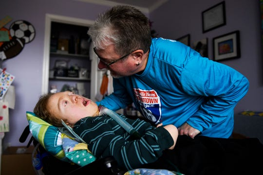 Bennie Waddell embraces his 19-year-old son Ben inside their home on Friday, Dec. 7, 2018. Ben was born with Pallister-Killian Mosaic Syndrome, or PKS, a rare genetic condition that results in cognitive and physical disabilities.
