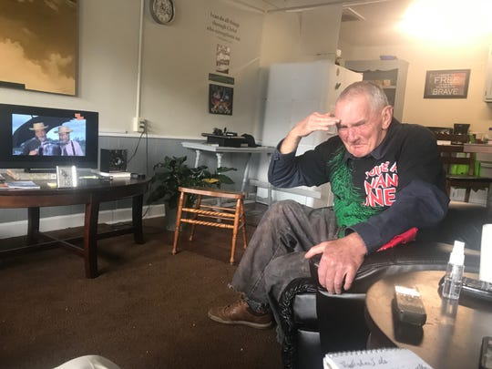 Hoyle Cox, a homeless Vietnam veteran, salutes as he breaks into tears while retelling of his bloody encounter with a Viet Cong soldier.
