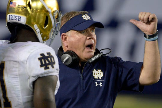 Oct 27, 2018; San Diego, CA, USA; Notre Dame Fighting Irish head coach Brian Kelly (right) reacts during the fourth quarter against the Navy Midshipmen at SDCCU Stadium. Mandatory Credit: Jake Roth-USA TODAY Sports