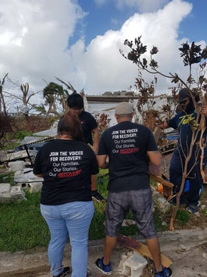 TOHGE Inc. members help in recovery efforts for Super Typhoon Yutu in Saipan.