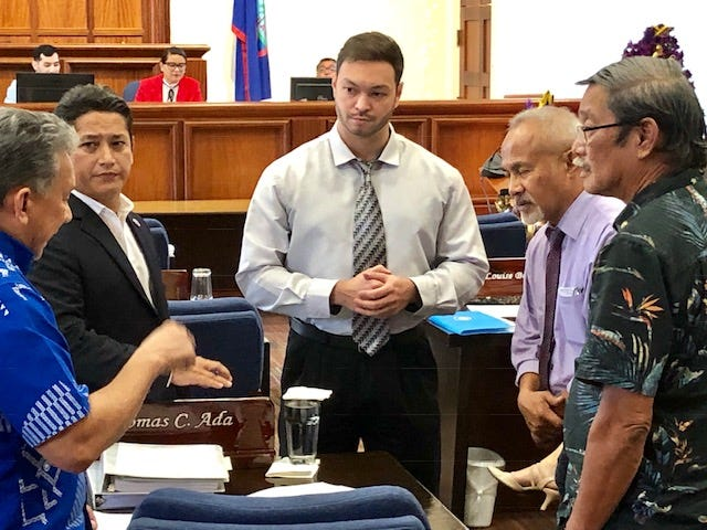 Senate Minority Leader Tom Ada, left, confers with Sens. Wil Castro, Mike San Nicolas, Jim Espaldon and Joe San Agustin right before the Dec. 10, 2018 session resumed after lunch break. Senators are trying to place as many bills possible on the agenda for the last session of the 34th Legislature.