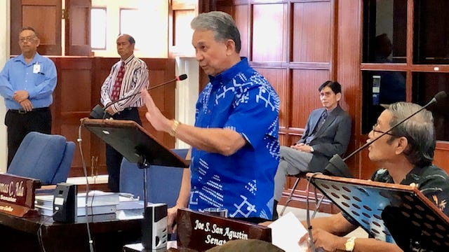 Senate Majority Leader Tom Ada, D-Tamuning, gestures on Monday, Dec. 10, 2018, as he makes a motion during the first day of the last session of the 34th Legislature, while Sen. Joe San Agustin, right, looks on.