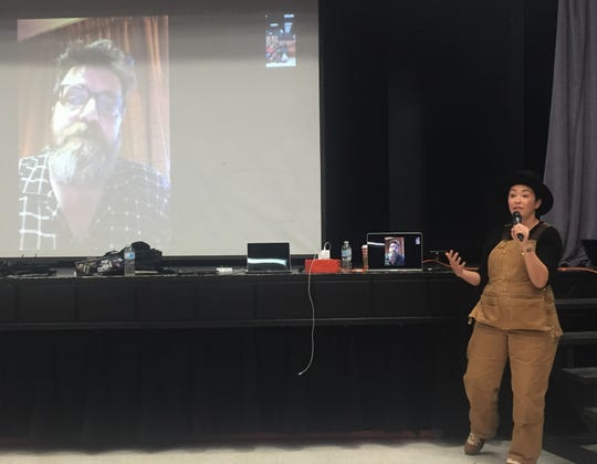 Emmy nominated costumer designer Ane Crabtree Skypes with production designer Mark White as she talks to Henderson students about the arts and show business on Monday.