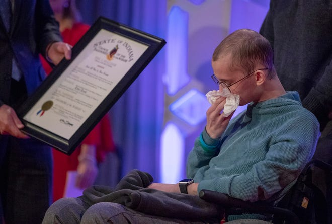 Tyler Trent wipes tears as he is presented with the Sagamore of the Wabash at a fundraiser luncheon for Riley Children's Foundation's Be The Hope Now campaign, Indianapolis, Wednesday, Nov. 28, 2018. Trent, who has the rare bone cancer osteosarcoma, is in hospice care.