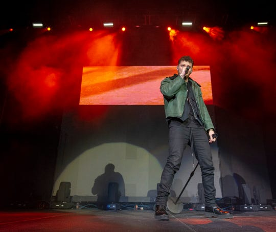 "Bazzi performs on stage. Radio stations Hot 96.3 and Radio Now 100.9 hosted the annual ""Santa Slam"" concert, featuring American hip hop trio Migos, in the Indiana Farmers Coliseum at the Indiana State Fairgrounds in Indianapolis, Sunday, Dec. 9, 2018."