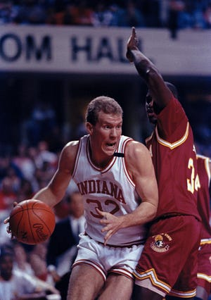Eric Anderson of Indiana drives through Rodney Dobard of Florida State during their NCAA Southeast Regional second round game in Louisville, March 16, 1991.