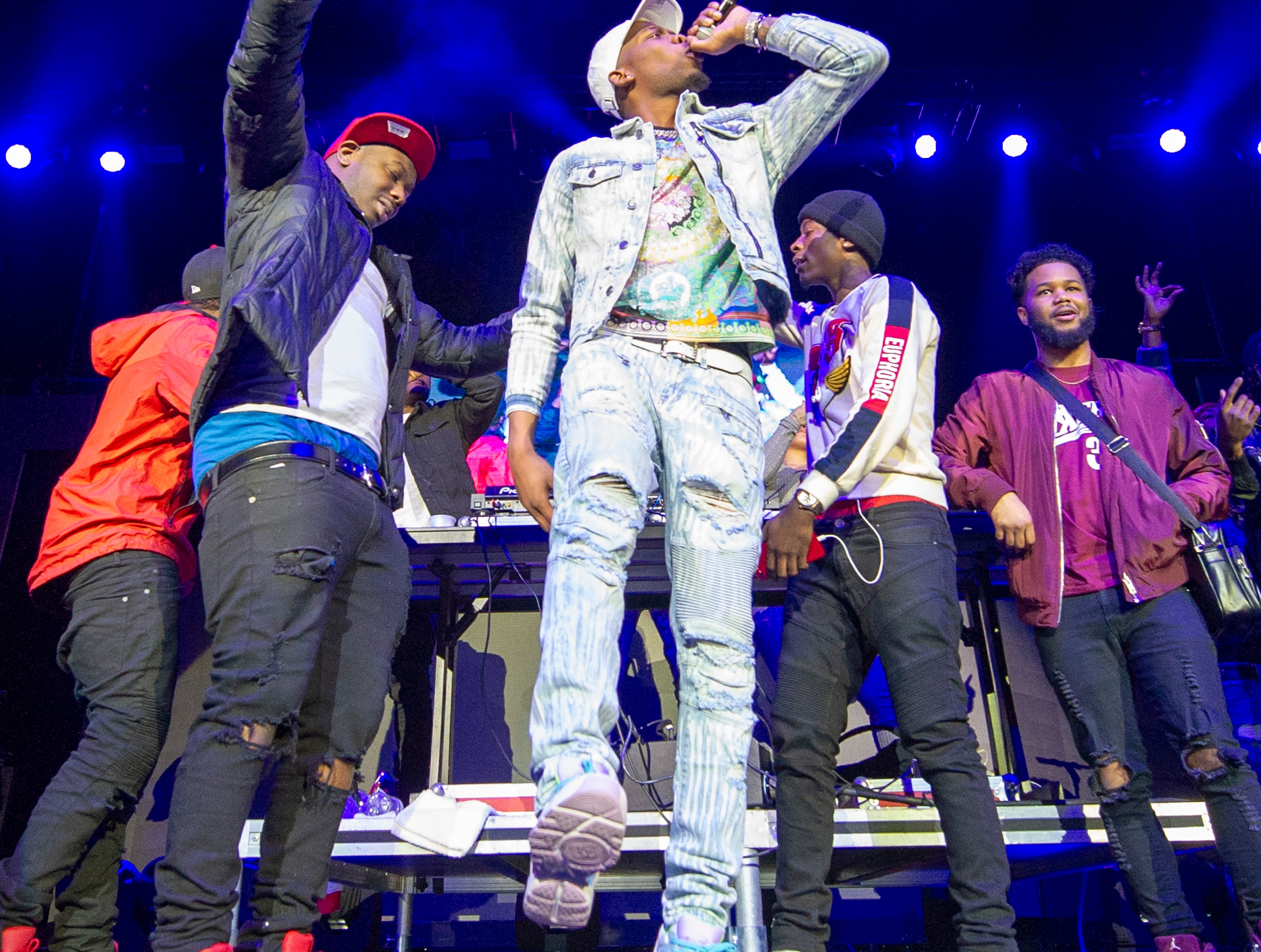 """BlocBoy JB performs on stage. Radio stations Hot 96.3 and Radio Now 100.9 hosted the annual """"Santa Slam"""" concert, featuring American hip hop trio Migos, in the Indiana Farmers Coliseum at the Indiana State Fairgrounds in Indianapolis, Sunday, Dec. 9, 2018."""