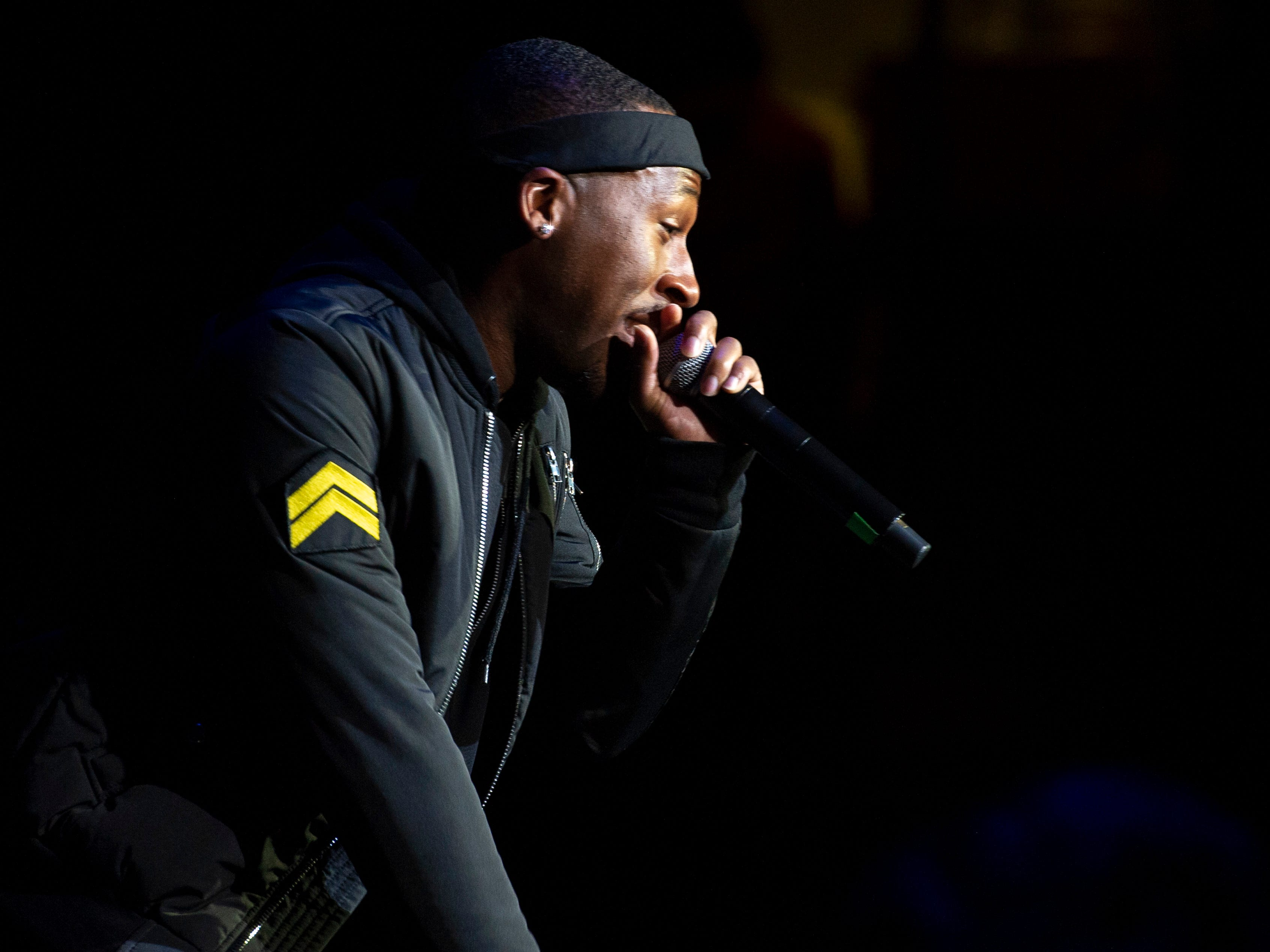 """Jonn Hart performs on stage. Radio stations Hot 96.3 and Radio Now 100.9 hosted the annual """"Santa Slam"""" concert, featuring American hip hop trio Migos, in the Indiana Farmers Coliseum at the Indiana State Fairgrounds in Indianapolis, Sunday, Dec. 9, 2018."""
