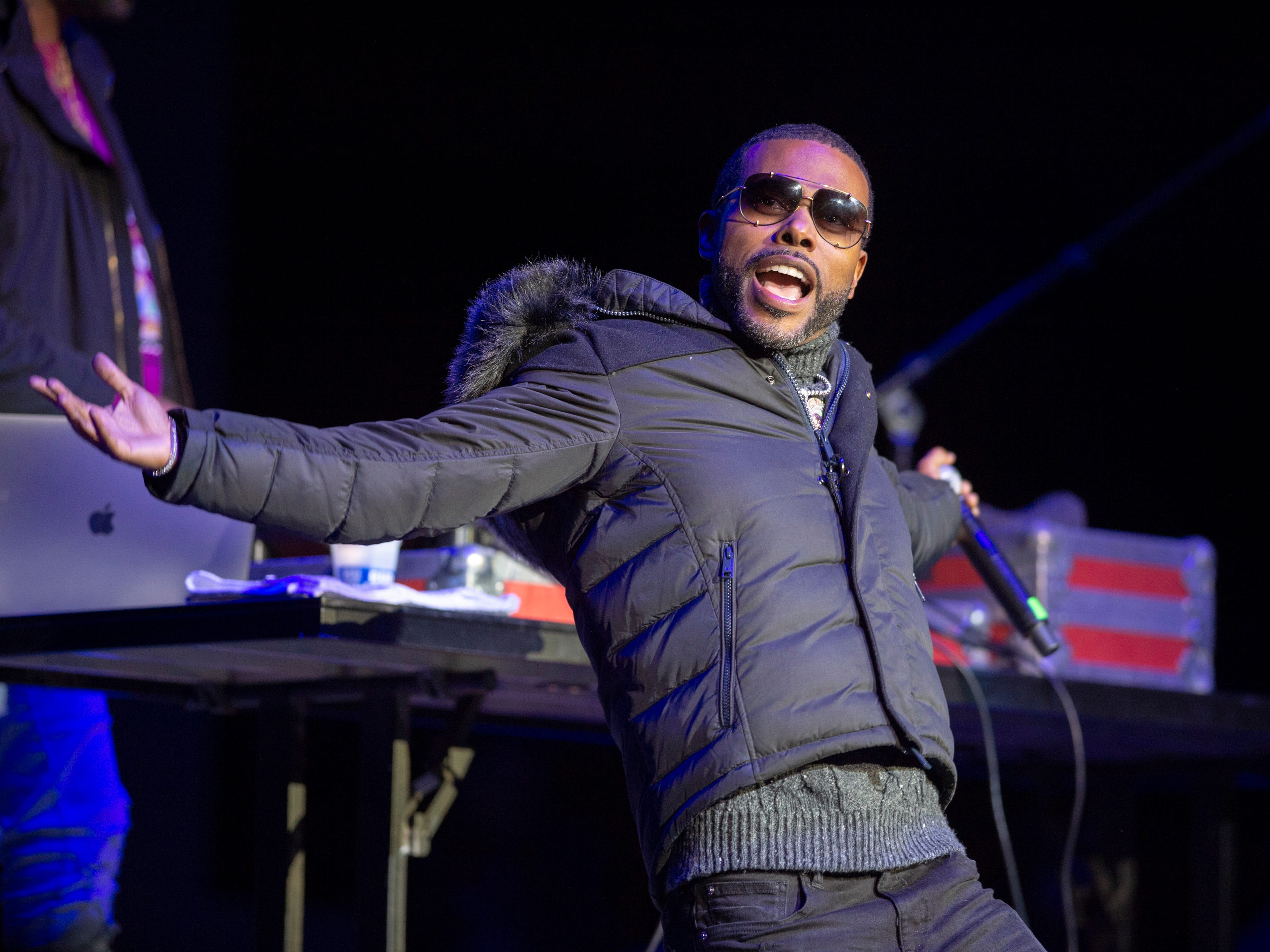 """Lil Duval performs on stage. Radio stations Hot 96.3 and Radio Now 100.9 hosted the annual """"Santa Slam"""" concert, featuring American hip hop trio Migos, in the Indiana Farmers Coliseum at the Indiana State Fairgrounds in Indianapolis, Sunday, Dec. 9, 2018."""