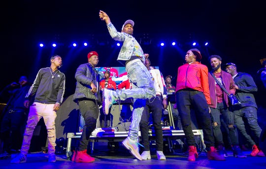 """BlocBoy JB performing his """"Shoot"""" dance during a concert in Indianapolis on Dec. 9,2018."""