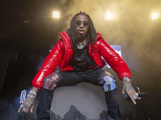 """Quavo performs with Migos Sunday at Indiana Farmers Coliseum. The images on Quavo's pants represent the female and male leads of 1981 film """"Christiane F. -- We Children from Bahnhof Zoo."""""""