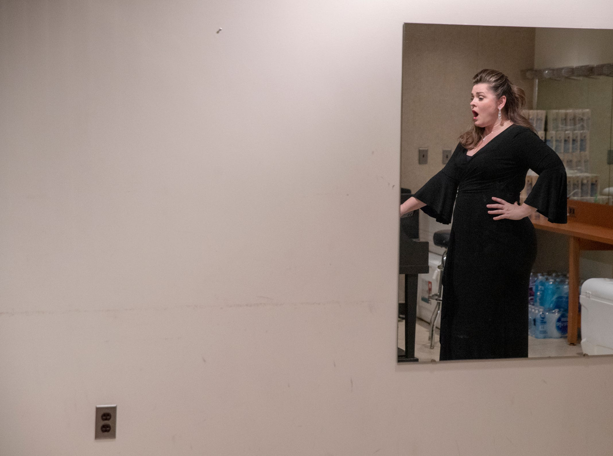 Michele McConnell warms up in a rehearsal room prior to the evening's Festival of Carols performance at Warren Performing Arts Center, Sunday, Dec; 9, 2018. McConnell is a soprano from Indianapolis, and has lived and performed at the highest level in New York for the past 20 years. Dance Kaleidoscope and Indianapolis Chamber Orchestra joined the Indianapolis Symphonic Choir for the show, that will be repeated several more times in the area this season.