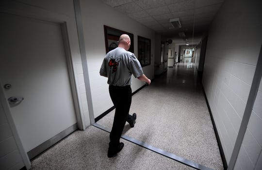 Beech Grove coach Matt English heads to the court after leaving the locker room before playing Park Tudor in 2011.