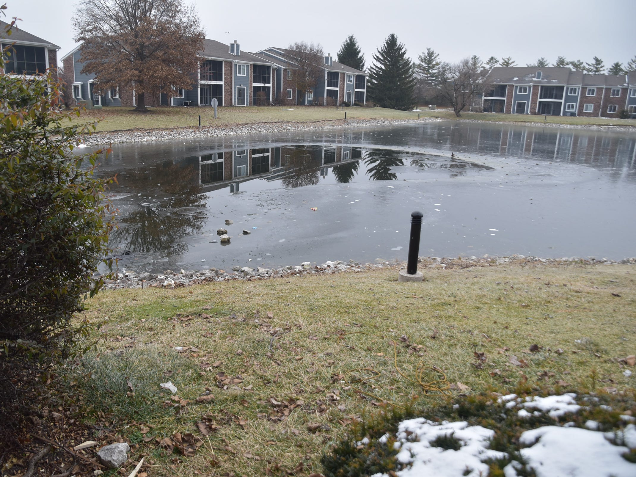 IFD Tactical Dive Team 14 worked to rescue a man, in his 20s, who fell through the ice on this pond at The Masters Apartments at 7039 PGA Drive, as he entered to rescue his dog who had gone out on the ice.  The man later died and was pronounced dead at St. Vincent Hospital.  The dog got out on his own, at the scene and survived.