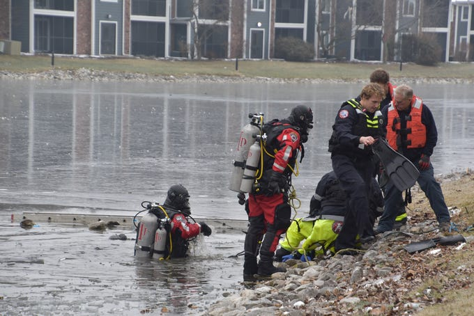 IFD Tactical Dive Team 14 works to rescue a man, in his 20s, who fell through the ice on this pond at The Masters Apartments at 7039 PGA Drive, as he entered to rescue his dog who had gone out on the ice.  The man later died and was pronounced dead at St. Vincent Hospital.  The dog got out on his own, at the scene and survived.