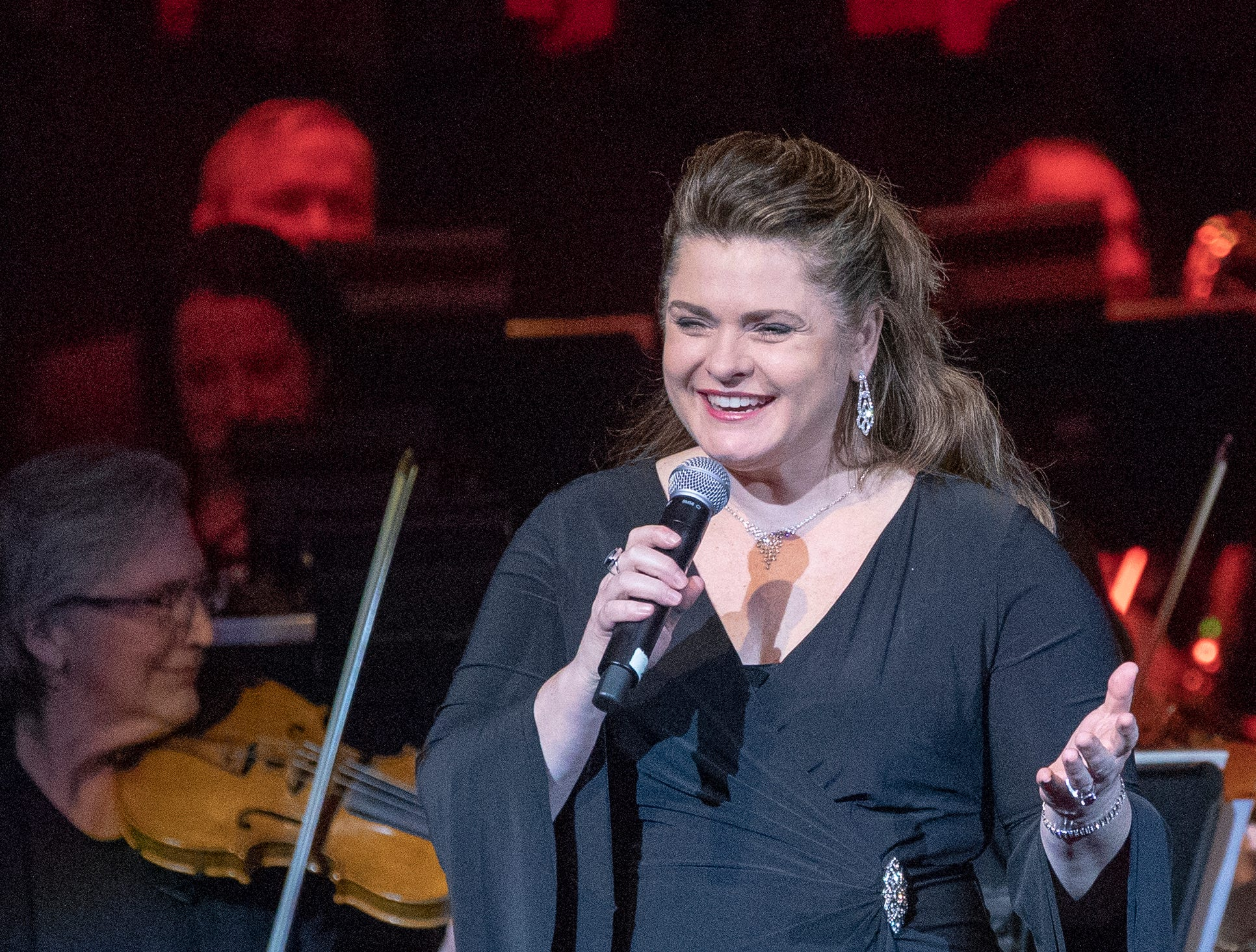 Michele McConnell on stage during the evening's Festival of Carols performance at Warren Performing Arts Center, Sunday, Dec; 9, 2018. McConnell is a soprano from Indianapolis, and has lived and performed at the highest level in New York for the past 20 years. Dance Kaleidoscope and Indianapolis Chamber Orchestra joined the Indianapolis Symphonic Choir for the show, that will be repeated several more times in the area this season.