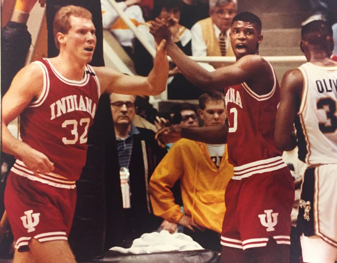 Eric Anderson (32) and Calbert Cheaney high-five during IU's 1991 game against Purdue.