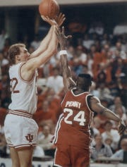 Eric Anderson scores over Coastal Carolina's Brian Penny late in the fourth quarter. March 14, 1991  photo