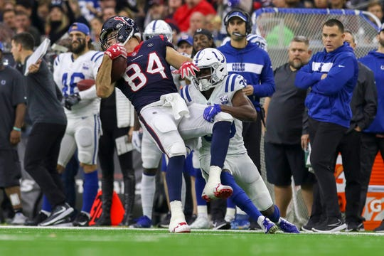 Colts cornerback Pierre Desir (35) tackles  Texans tight end Ryan Griffin (84).