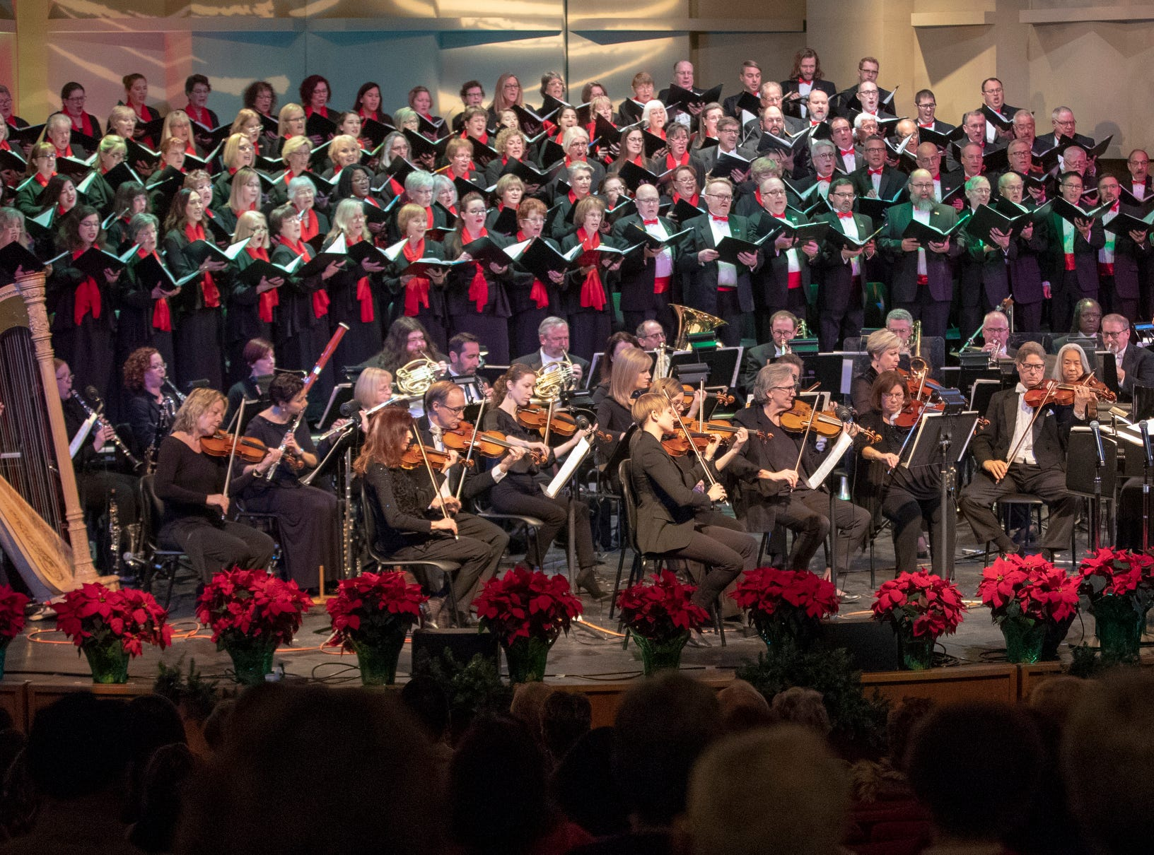 The evening's Festival of Carols performance at Warren Performing Arts Center, Sunday, Dec; 9, 2018. Michele McConnell (not on stage) is a soprano from Indianapolis, and has lived and performed at the highest level in New York for the past 20 years. Dance Kaleidoscope and Indianapolis Chamber Orchestra joined the Indianapolis Symphonic Choir for the show, that will be repeated several more times in the area this season.