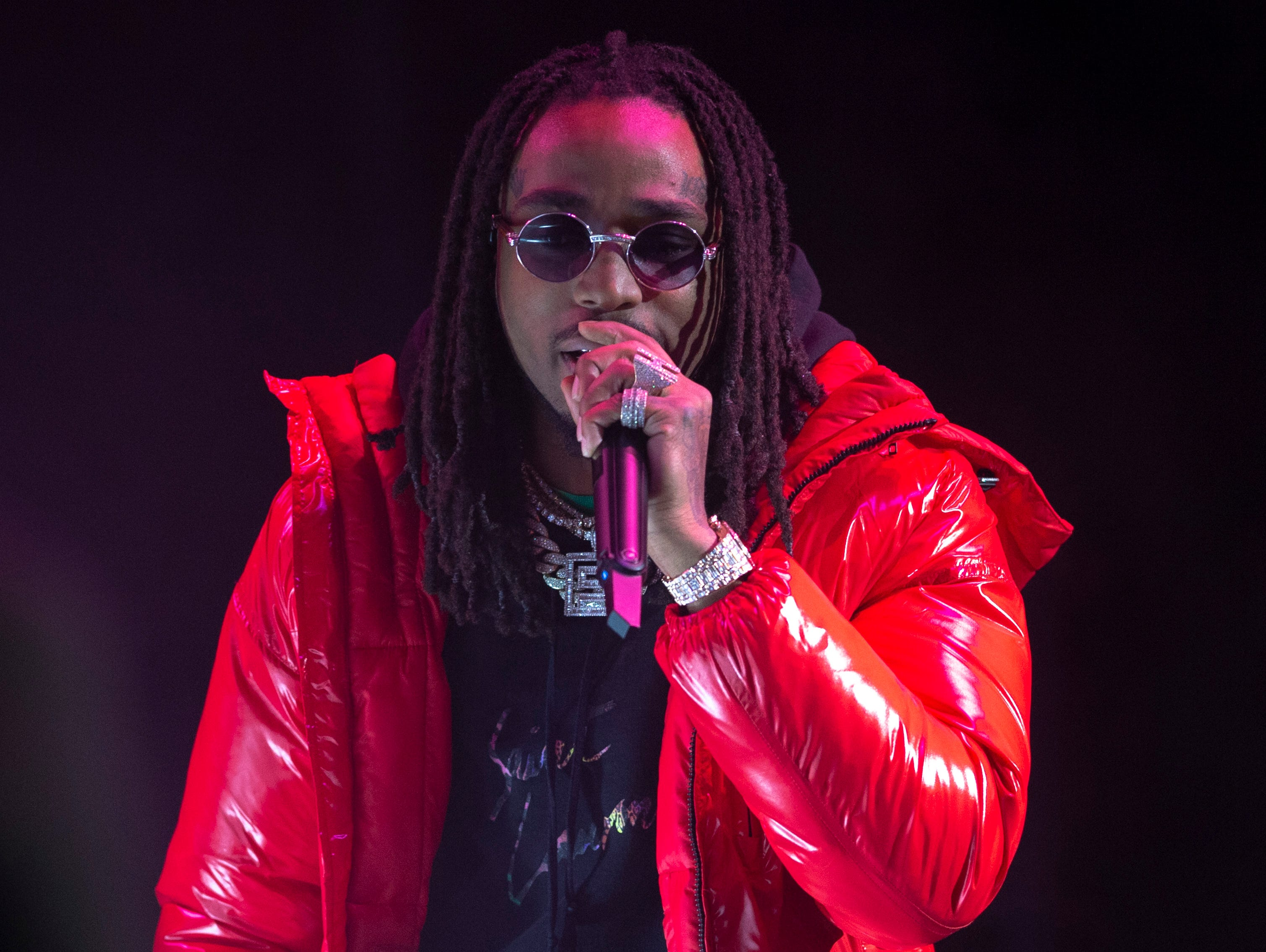 """Migos perform on stage. Radio stations Hot 96.3 and Radio Now 100.9 hosted the annual """"Santa Slam"""" concert, featuring American hip hop trio Migos, in the Indiana Farmers Coliseum at the Indiana State Fairgrounds in Indianapolis, Sunday, Dec. 9, 2018."""