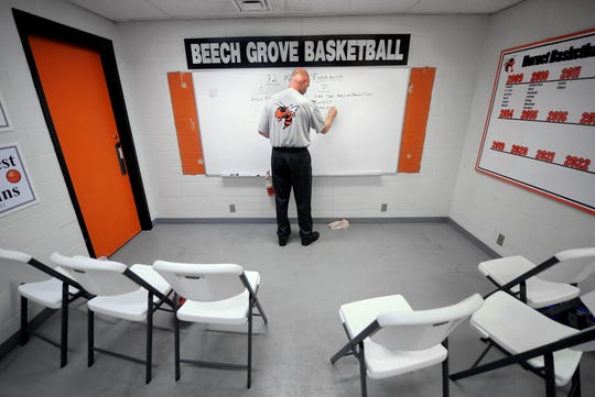 Beech Grove's Matt English puts some thoughts into instruction on the white board in the locker room before playing Park Tudor Dec. 9, 2011.
