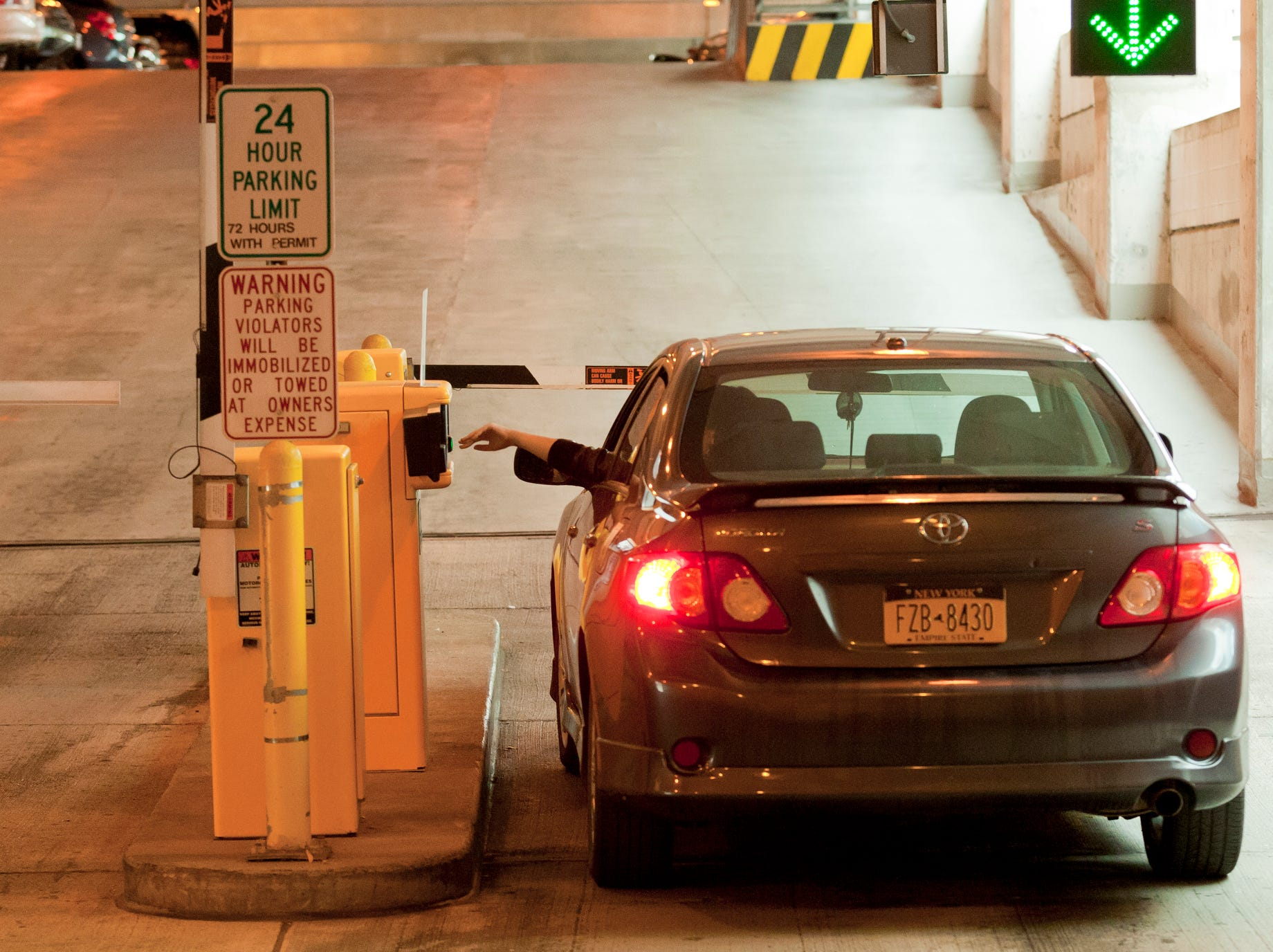 A motorist gets their ticket as the enter the Green Street Parking Garage in the City of Ithaca.
