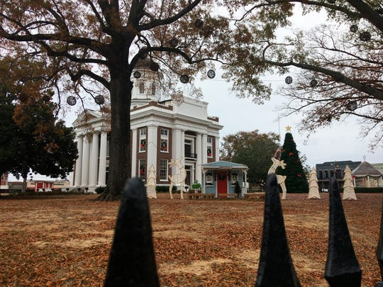 The Madison County Courthouse is seen decorated for Christmas Friday, Dec. 7, 2018, in Canton. Seven people have been arrested on voter fraud charges connected to the 2017 city elections in Canton.