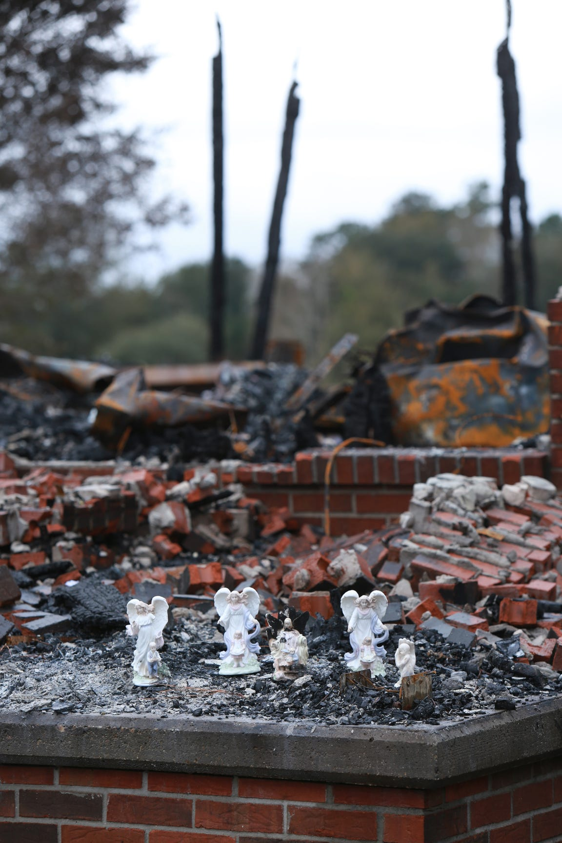 The only possessions that were left unscathed from a fire that destroyed the Haas family home in Kiln, Miss., were four blessed angel figurines guarding children. A fifth angel also remained. Her backside, her wings, were burned in the fire on Nov. 25, 2019.
