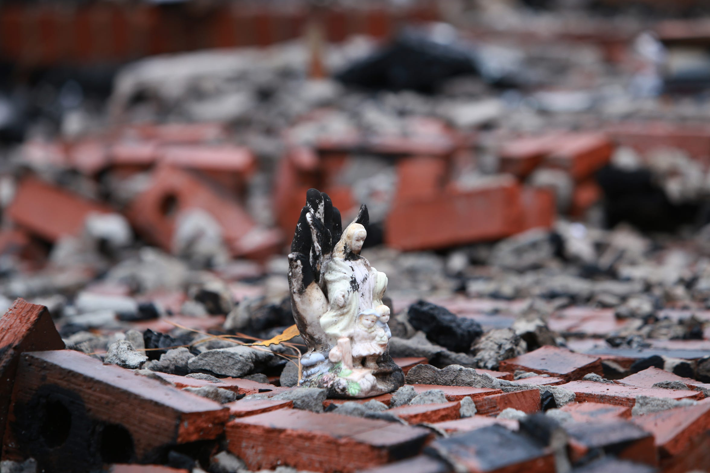 An angel figurine was one of the possessions left in the rubble of a house fire that destroyed the Haas home in Kiln, Miss., on Nov. 25, 2018.