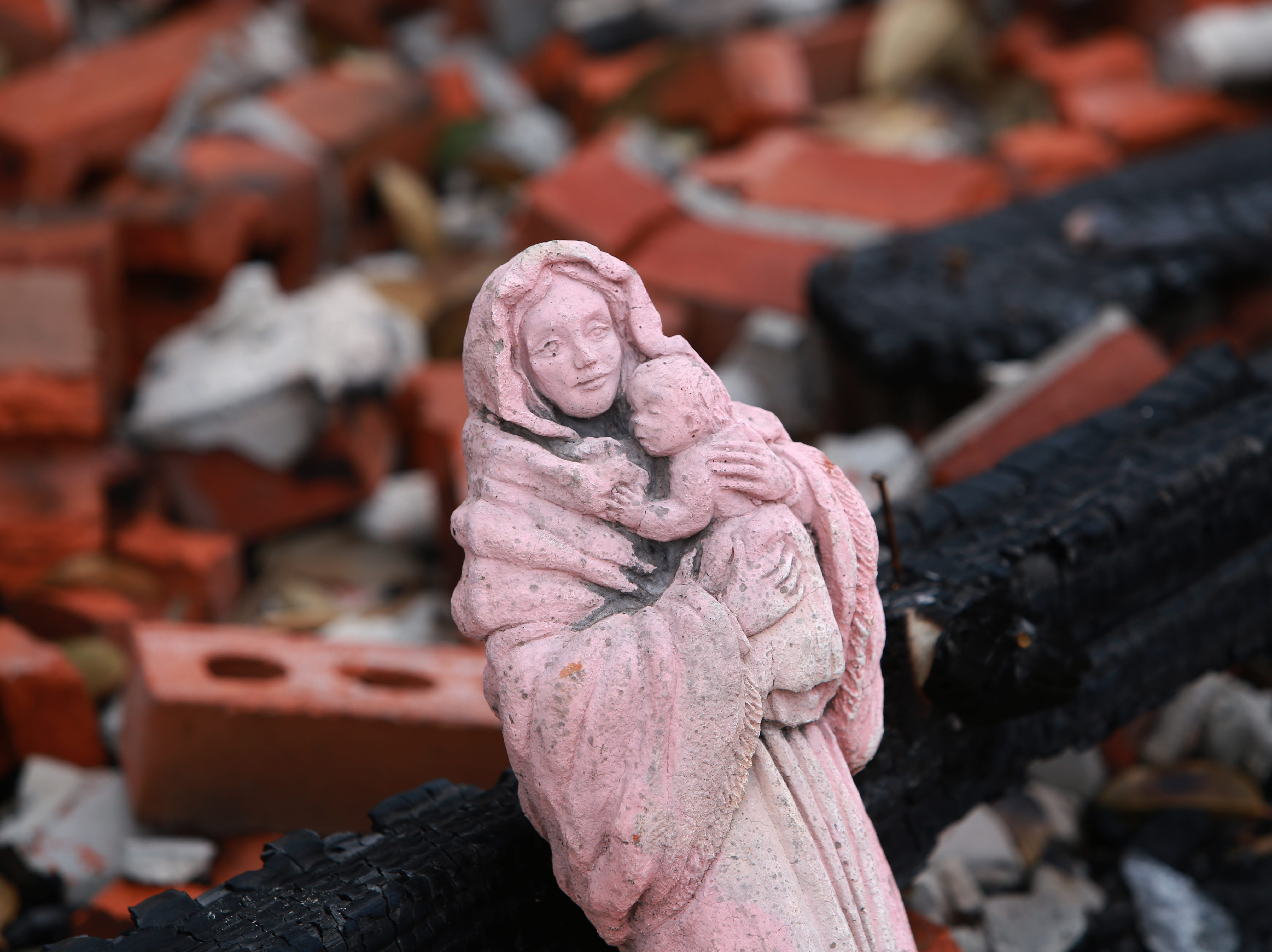 """Mother and Child,"" a statue of the Blessed Mother and Jesus, is one of the only possessions left in a house fire that destroyed the Haas family home in Kiln, Mississippi, on Nov. 26, 2018."