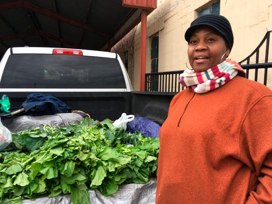 Elaine Blair sells collard greens, mustard greens and turnip greens out of the back of her pickup Friday, Dec. 7, 2018, in Canton. Blair, who lost a 2015 election for a seat on the Canton Board of Aldermen, says she was not surprised to hear that seven people, including the person who defeated her, are now facing voter fraud charges connected to the 2017 Canton city elections. AP