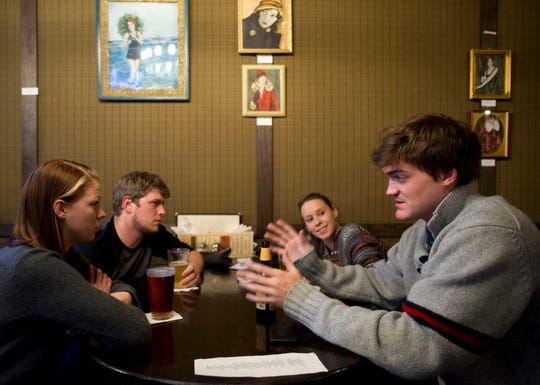 A group competes in a trivia night at Central Flats & Taps in this 2013 file photo.